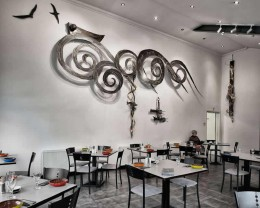 Original sculpture on restaurant wall